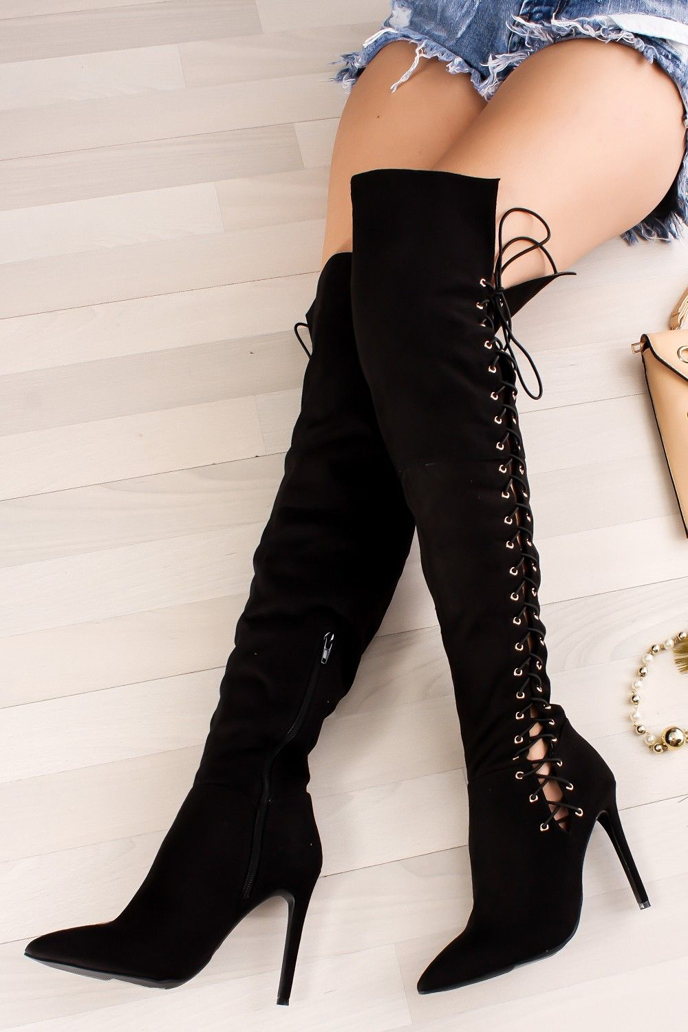 98e8a20fea8 This faux suede over the knee boots features a 4 inch high heel ...