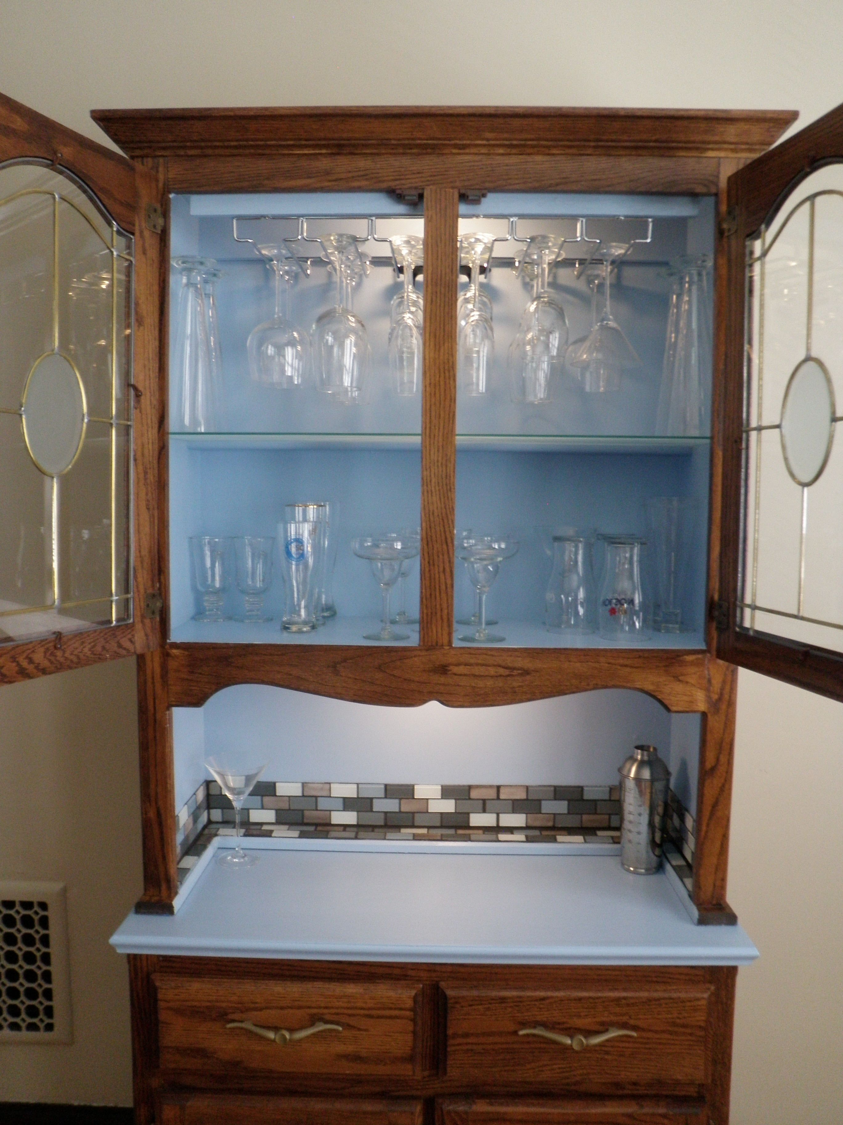 My repurposed china cabinet... painted it, added the backsplash ...