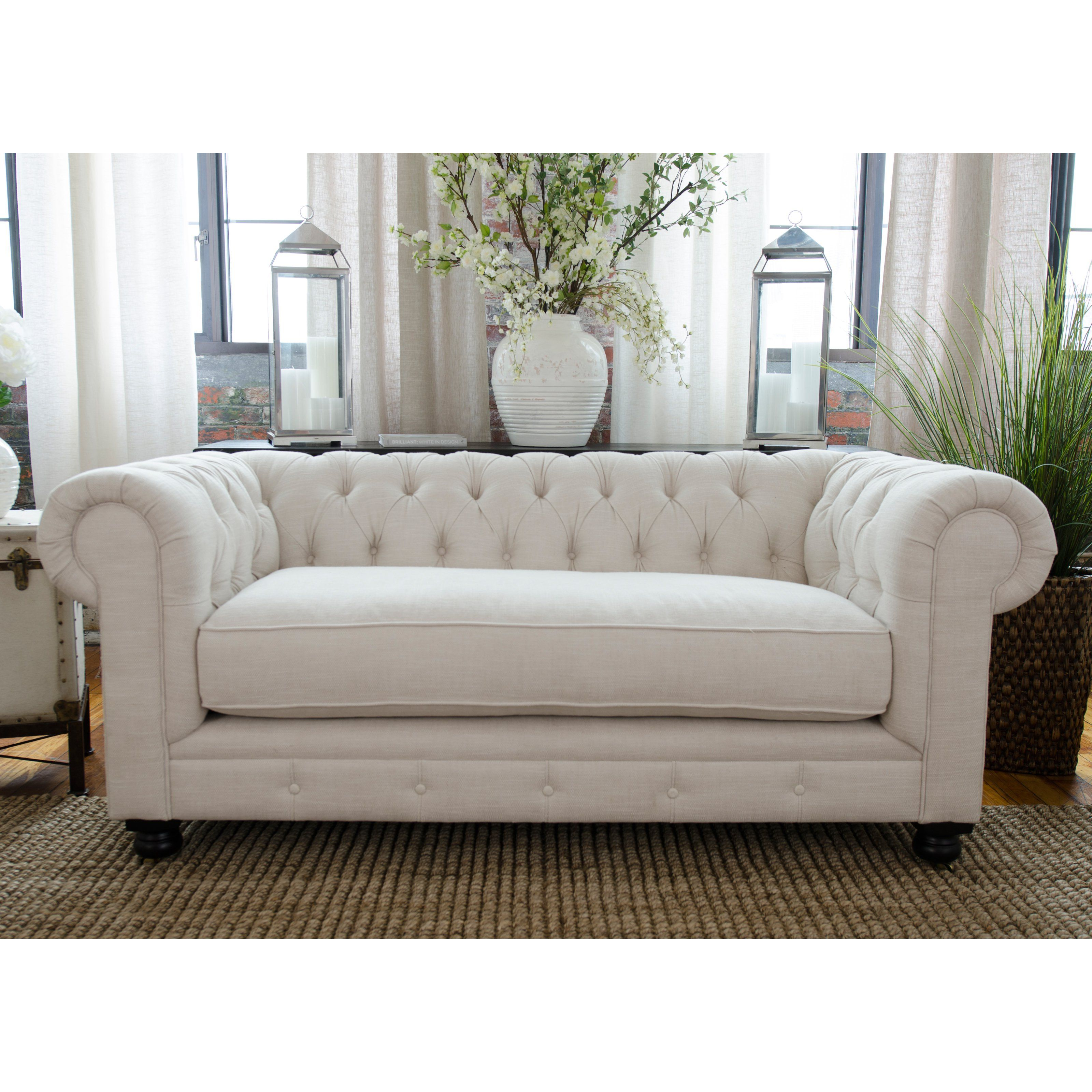 A Chesterfield Loveseat Is So Classic Arms At The Same Height As