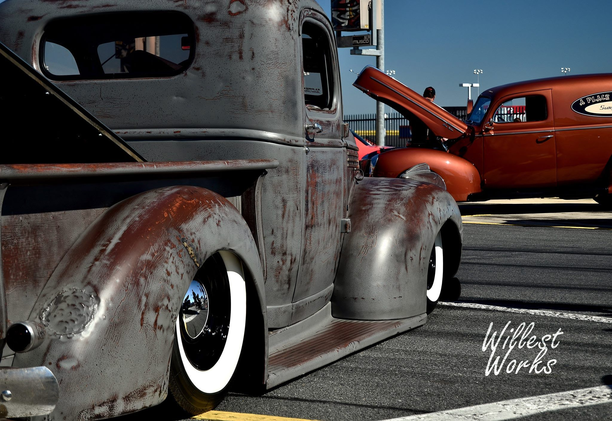 Ford Pickup Truck Ratrod Slammed Laid Out On White Wall Tires 1955 F100 Pancaked Wrapped Around Gloss Black Wheels And Topped With A Patina Original Paint Job