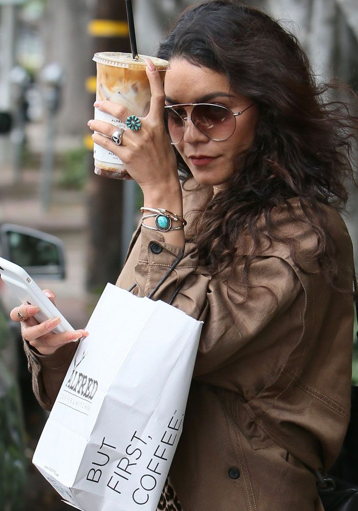 A camera shy Vanessa Hudgens leaves Alfred Cafe with a coffee on June 10, 2016