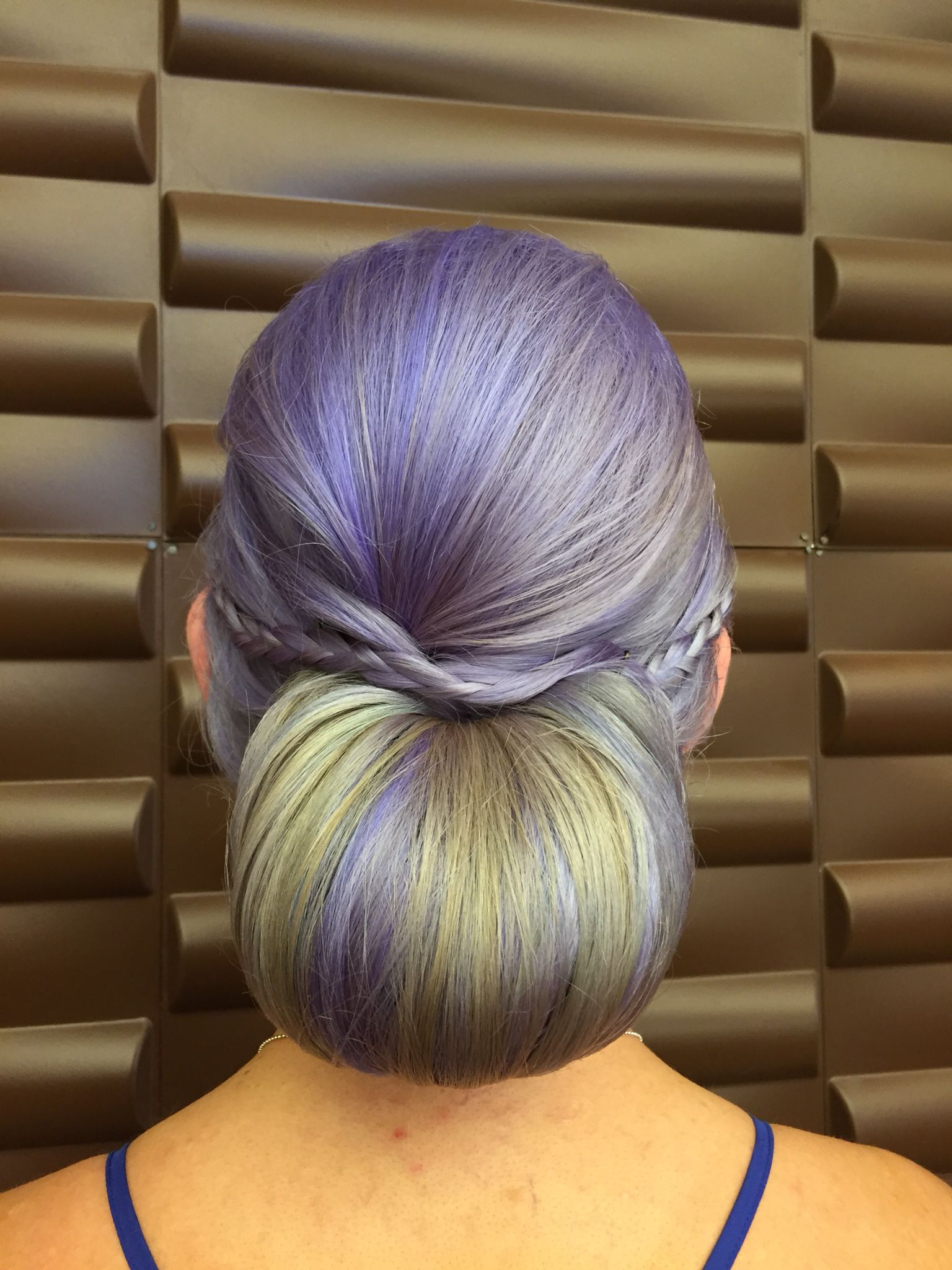 Beautiful lavender hair styled into a simple bridesmaid hair style with braids