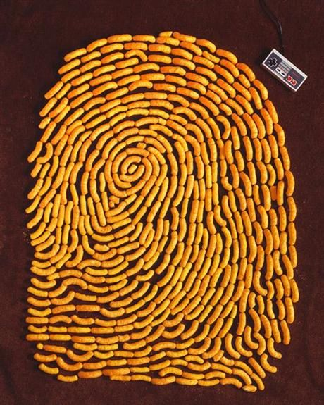 Kevin Van Aelst Food Art. Cheeto fingerprint! Brings new meaning to cheesy fingers huh?