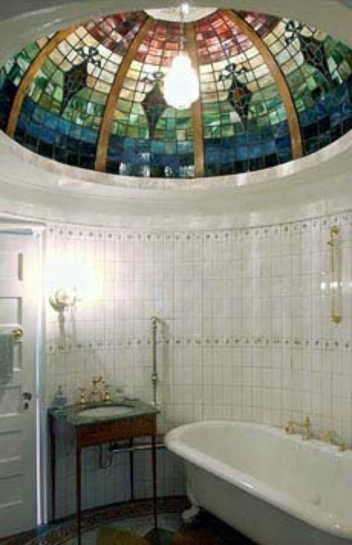 A beautiful stained glass window in this bathroom\u0027s ceiling