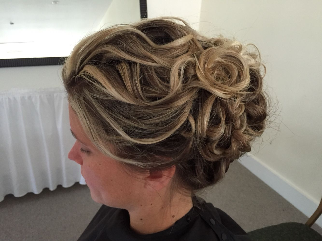 Lots of curls for this bridesmaid updo