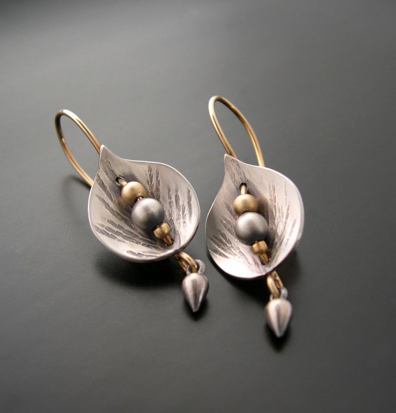 "Earrings | Aileen Lampman. ""leaf Shield"". Sterling silver and gold"