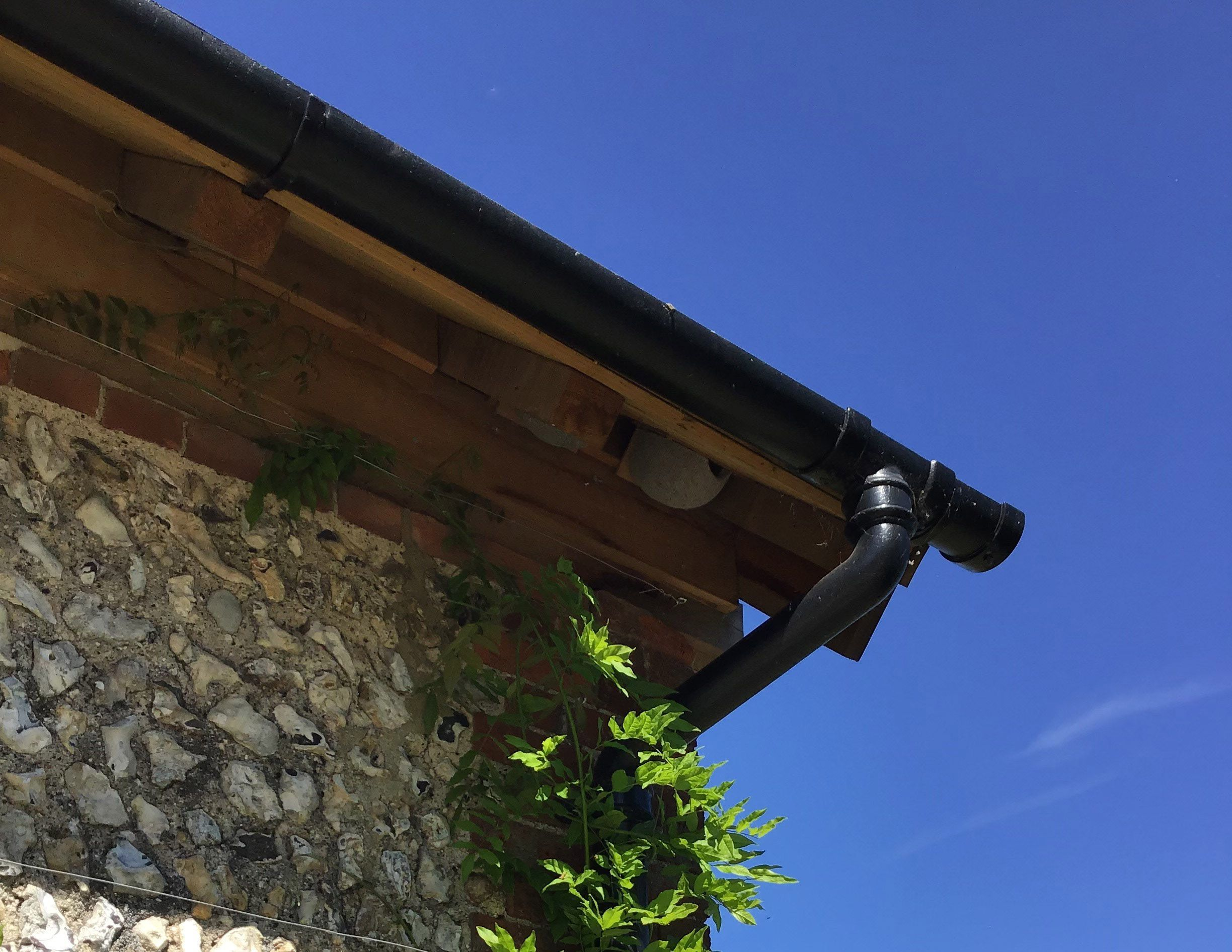 A Beautiful Example Of Cast Iron Guttering Top Fix Rafter Brackets Outlet Offset And Downpipe On A Stunning Blue Blue Sky Background Water Systems Cast Iron