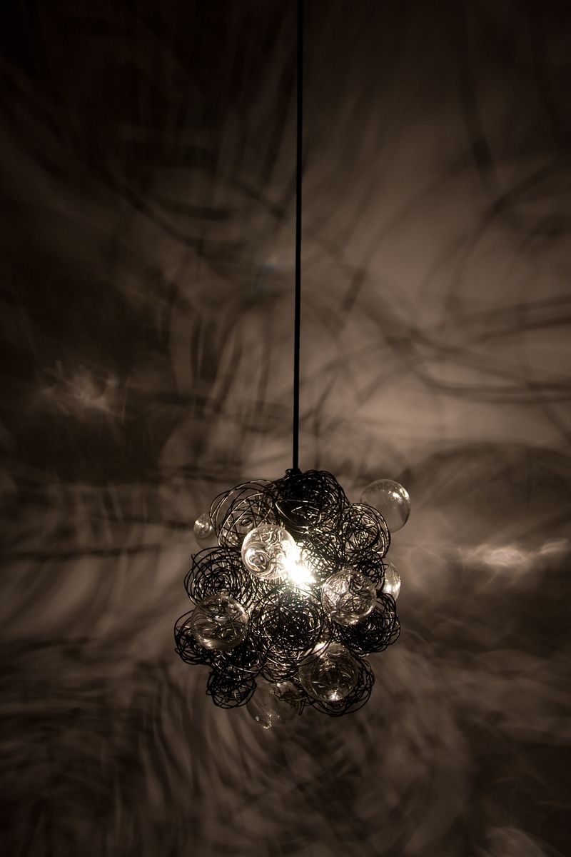Bundles Of Steel Wire Nests And Blown Glass Globes Create A Unique Pendant  Light That Creates An Effect Of Light And Shadow In The Space.