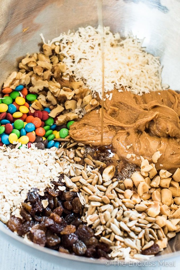 Healthy Trail Mix Protein Bites SAVE FOR LATER! These easy to make Trail Mix Protein Bites make a delicious treat for your weekend adventures or a healthy after school snack. They are naturally gluten-free and can easily be made vegan. Everyone will LOVE this recipe!