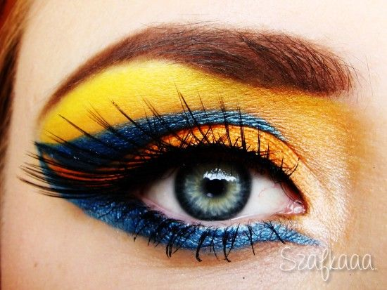1. add orange eyeshadow to upper lid 2. add yellow eyeshadow from the crease to the brow bone 3. add blue liquid liner (i used blue eyeshadow mixed with Inglot's Duraline) 4. make a thin line with black gel eyeliner and put on fake lashes 5. add white, shimmery eyeshadow to the inner corner 6. do the face and ombre lips (from light to hot pink)