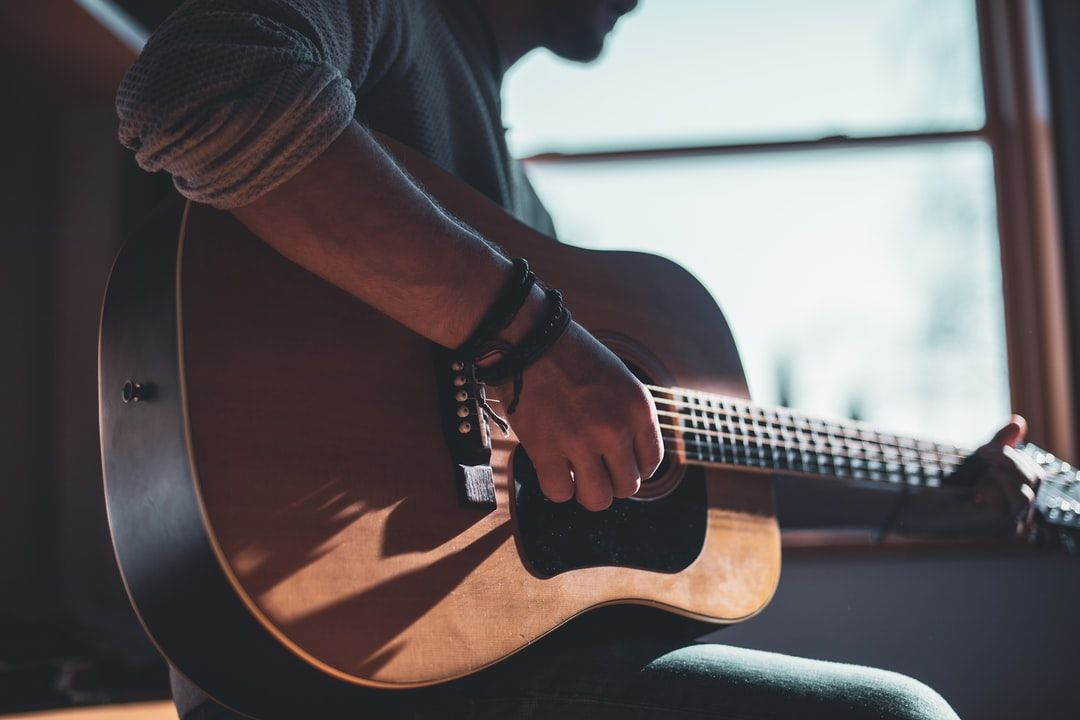 Guitar Player Download This Photo By Jacek Dylag On Unsplash Best Hobbies For Men Acoustic Guitar Photography Learn Guitar