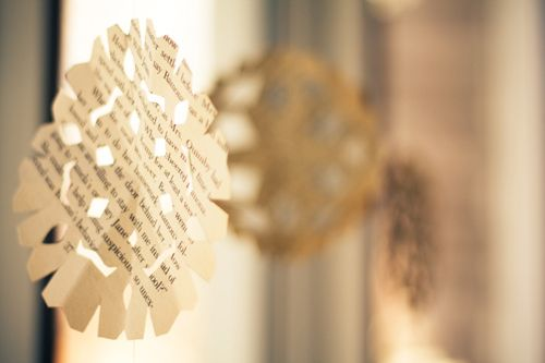Paper snowflakes made from old book pages.  I want to fill my dining room with them this year.