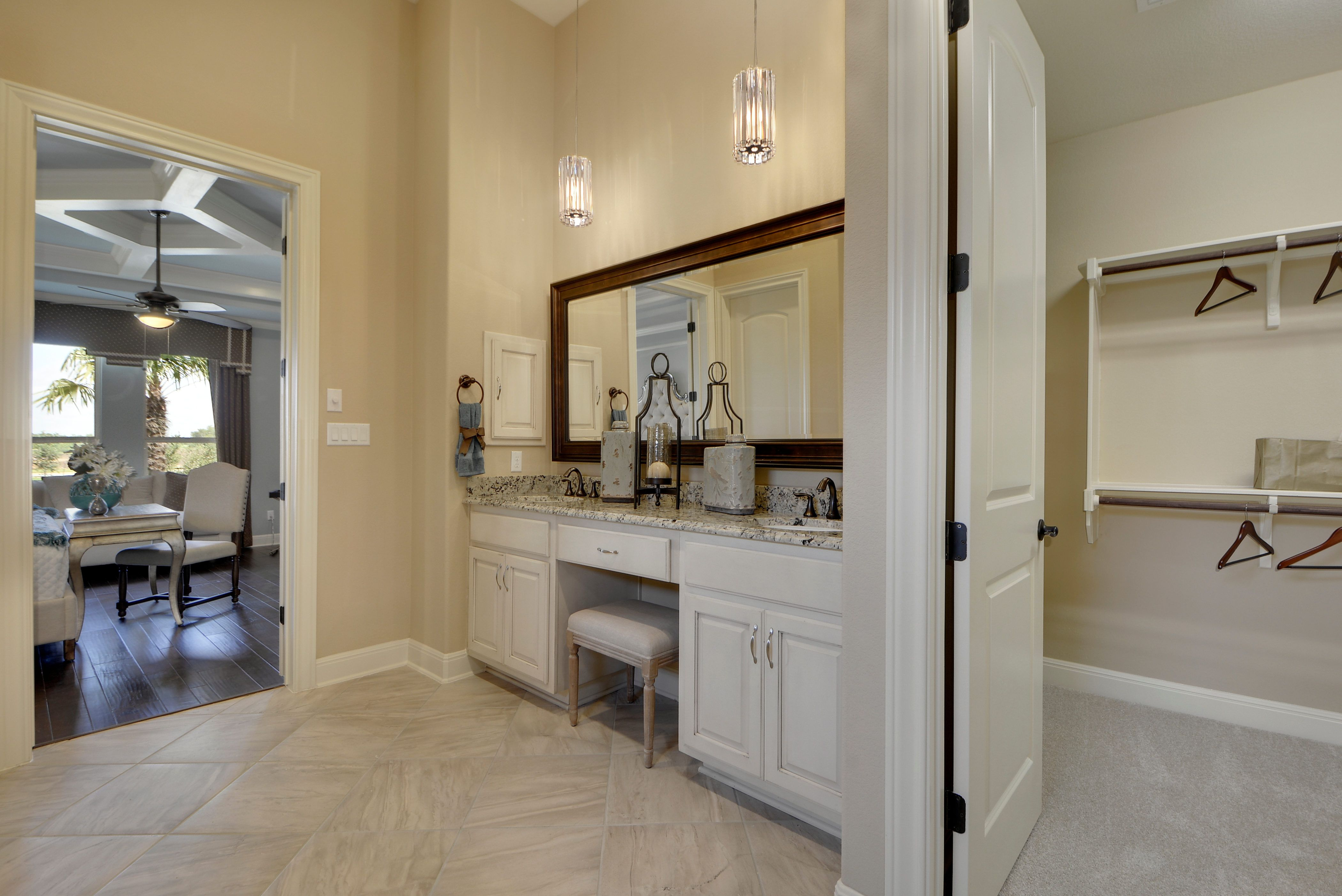 A Connected Master Bathroom With A Spacious Walk In Closet White Cabinetry And Beautiful