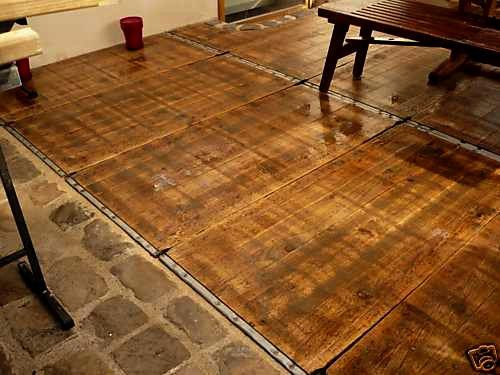 Steenschotten azobe pardenstallen houten vloeren planken terras