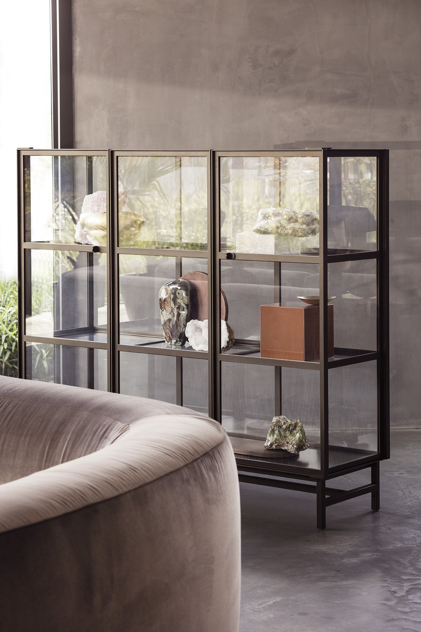 Steel FINN Cabinet, Round BO Sofa, Concrete Floor