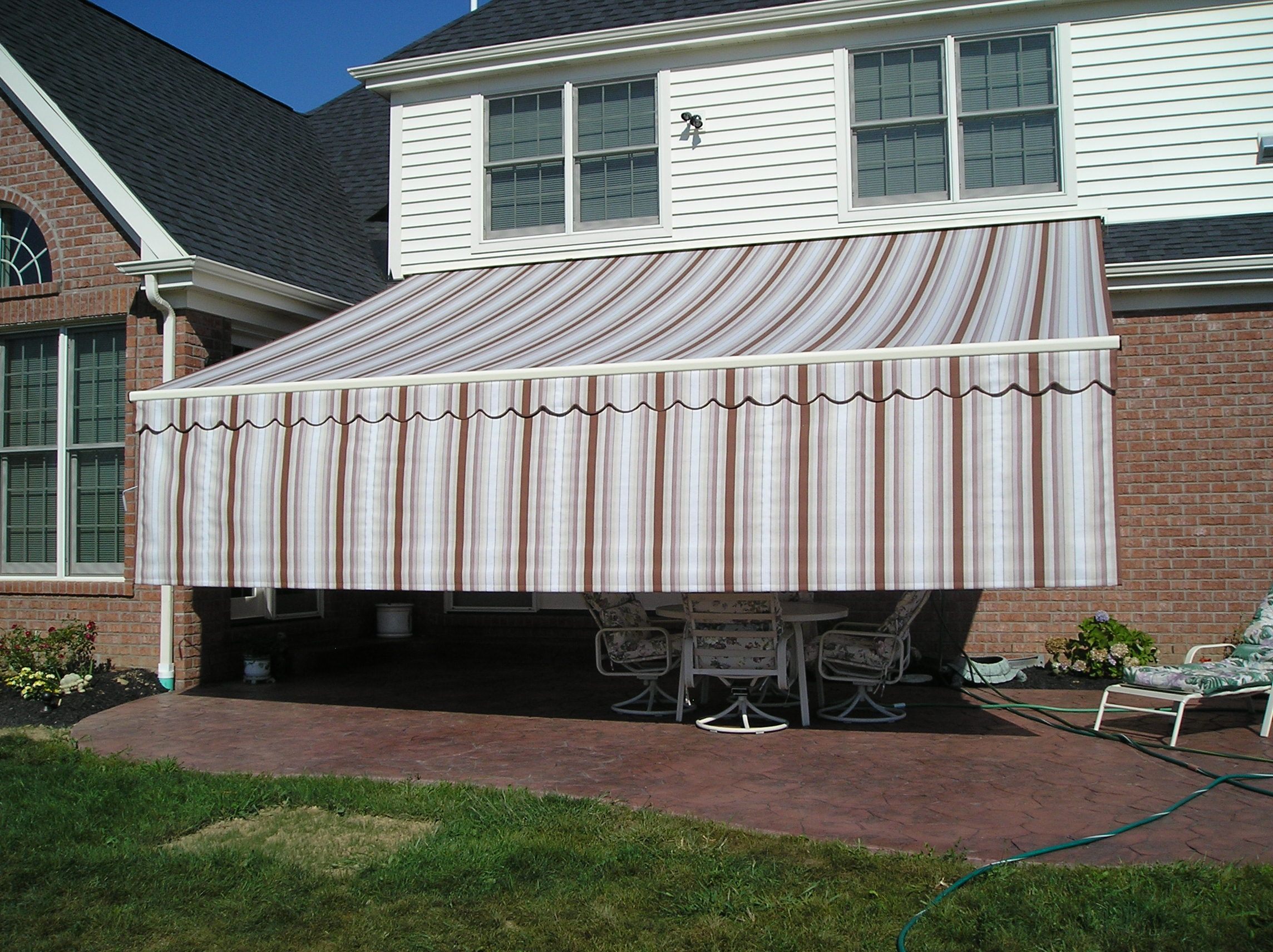 Sunair Retractable Awning With Drop Curtain On End From Thomas V. Giel  Corporation 800