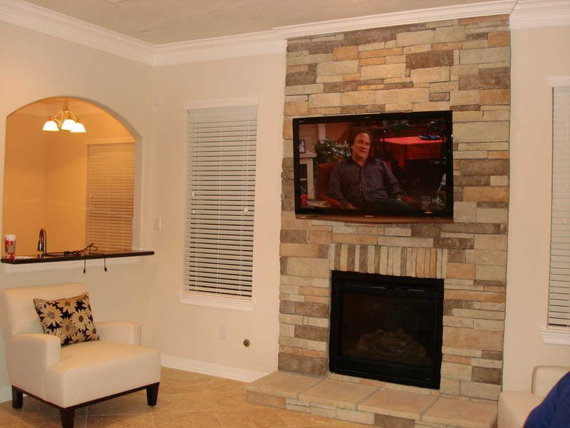 And No Tv Mounting Over Fireplace With Stone Wall