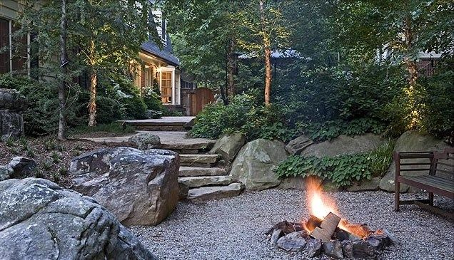 Stone fire ring country landscape design surrounds for Country landscaping ideas