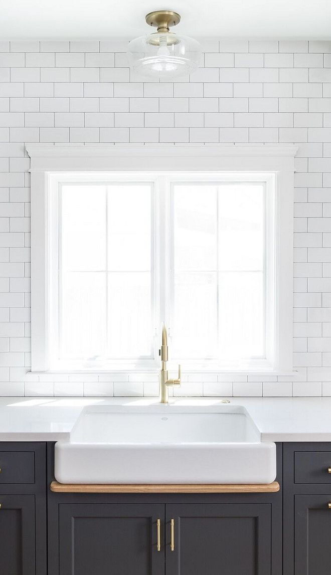 The backsplash is a traditional (and inexpensive) 3×6 white polished