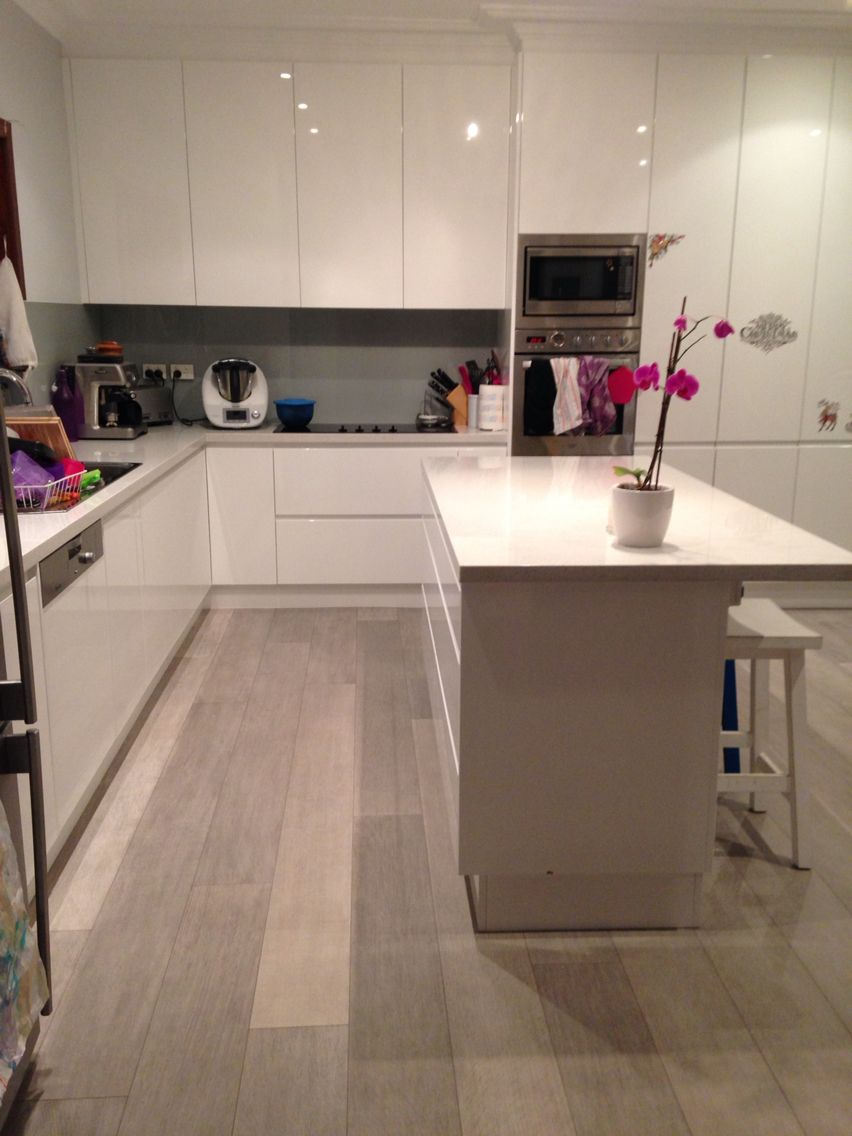 our new kitchen quickstep authentic oak laminate flooring white gloss polyurethane cabinetry. Black Bedroom Furniture Sets. Home Design Ideas
