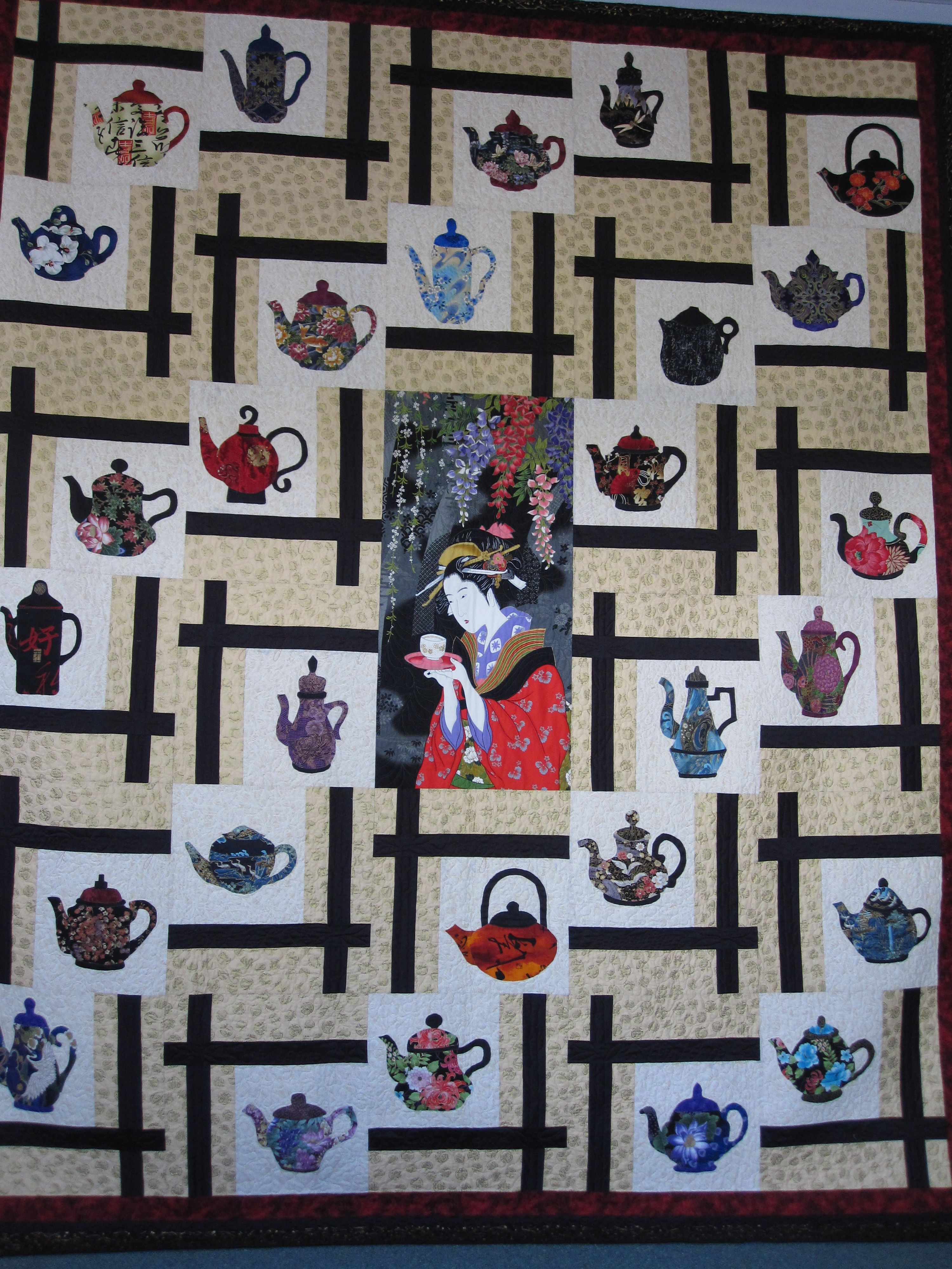 Oriental Teapot Quilt, with center panel. Blocks are BQ2 by Maple Island Quilts. Teapots are ...