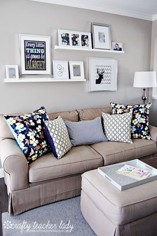 Shelving Ideas For Living Room Walls Furniture Small Spaces Apartment Above The Couch Simple Plank Floating Shelves Uses Large Frames Mounted On Wall An Picture Propped Up