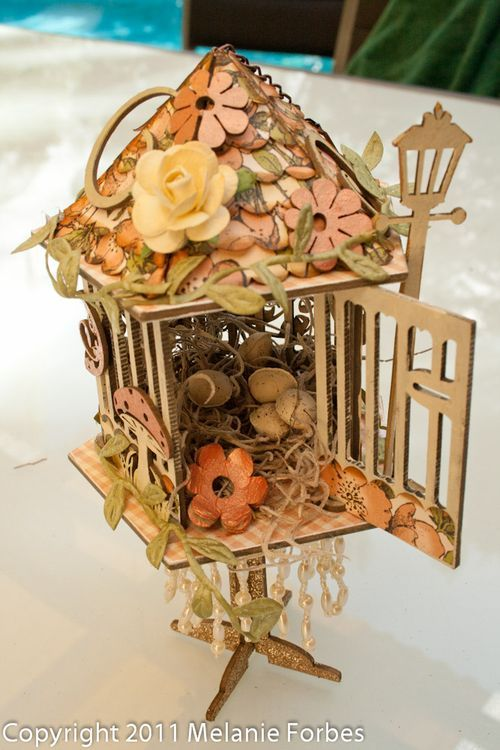 We will miss @Melanie Bauer Forbes so much! We are celebrating her today on our blog - look at this stunning altered Once Upon a Springtime birdhouse! #graphic45