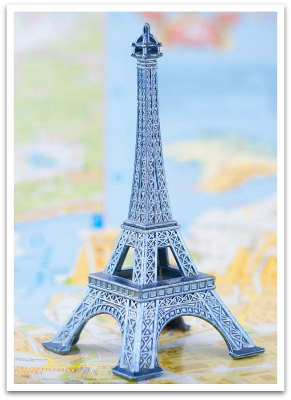 Model of the Eiffel Tower on a Colorful Map of Paris, France. from Depositphotos.com