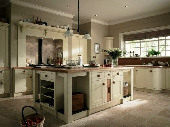 cherry cabinets with cream paint & travertine floors   ... And ...