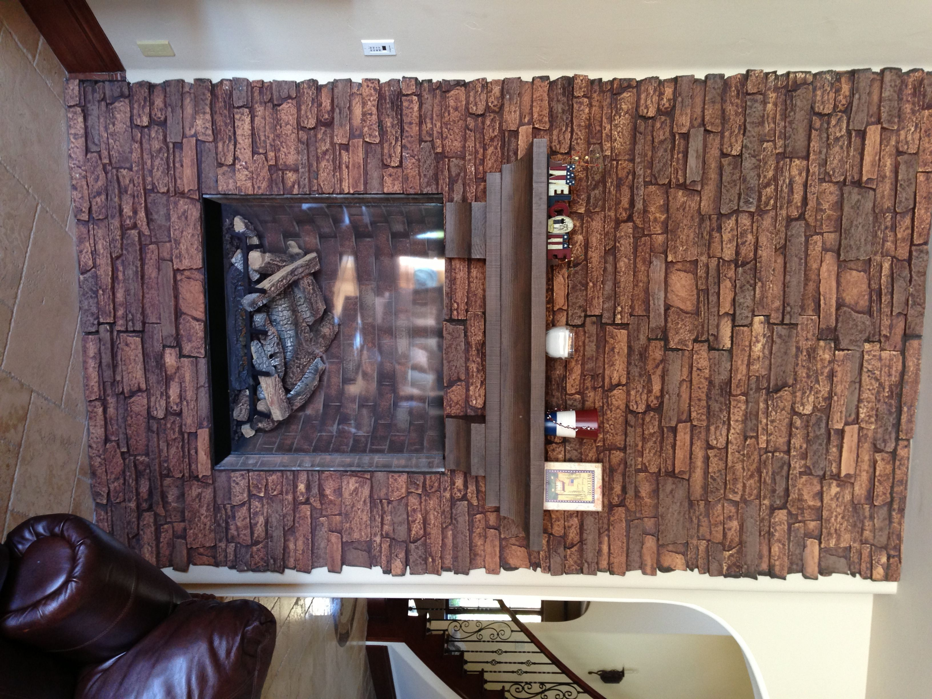 "Fake stone veneer panels clad this fireplace for an amazing new look. I would like to put this on the fireplace in new home... as well as behind TV in family room and into ""wine Tasting"" room to tie it all together... maybe even on the outside of the lower part of house for a custom look."