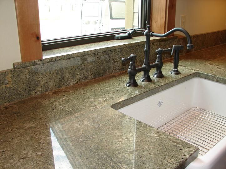 Seafoam Green Granite Kitchen Countertop With Antique Bronze Faucet And White Farm Sink Green Granite Countertops