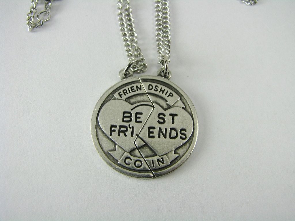 "Here is unique gift for you and your best friend! This very special Friendship Coin is factory engraved with interlocking hearts, and reads Best Friends, Friendship Coin when the two pieces are together. The coin is about the size of a quarter. The back side is blank - ready for me to engrave either your names or initials! Each piece comes on an 18"" cable chain with a spring ring clasp. This set is a great idea for you and your best friend or other special someone."