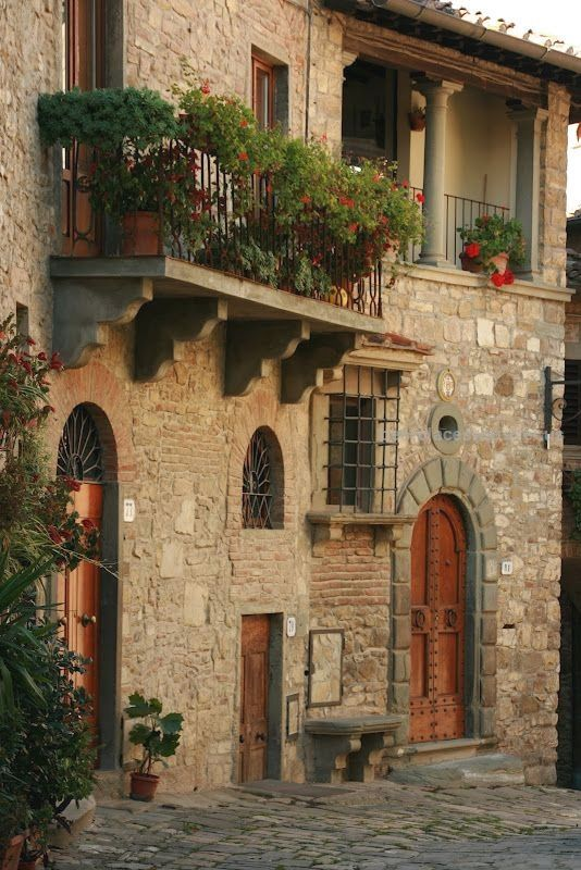 vignette design  Tuscay – In this small Tuscan town, flowers were in every window and balcony. Of course, everything looks better with a stone background  http://www.bestplacestotravel.us/2017/06/01/vignette-design/