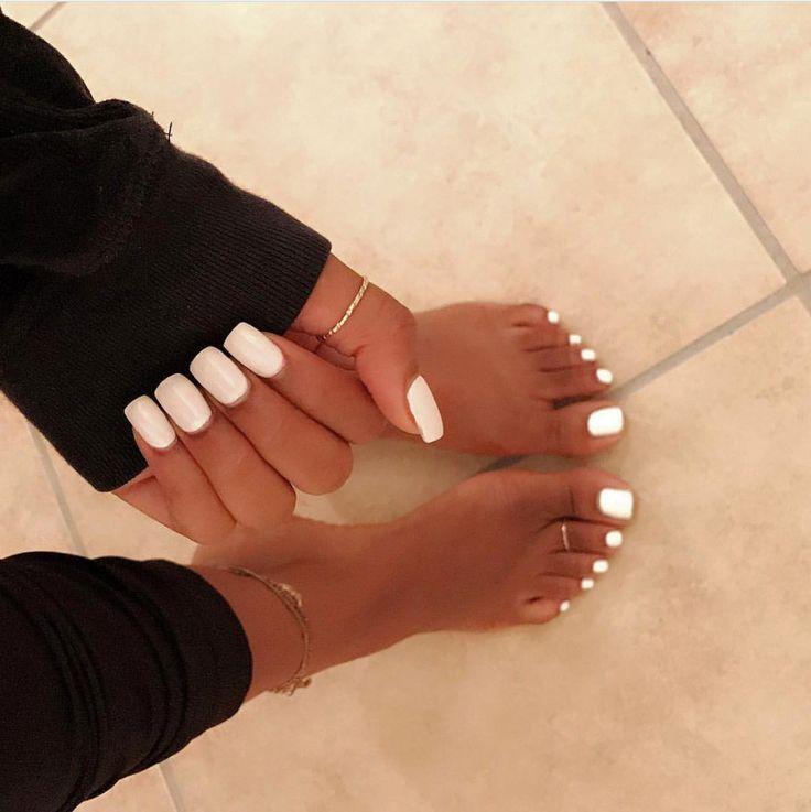 Matching white hand and toe nail style. White clean nail polish ...