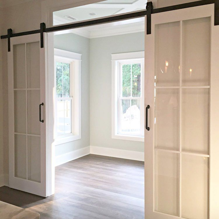 A Crisp Alternative To Barn Doors I M Liking This Look Glass Barn Doors Home Renovation Interior Barn Doors