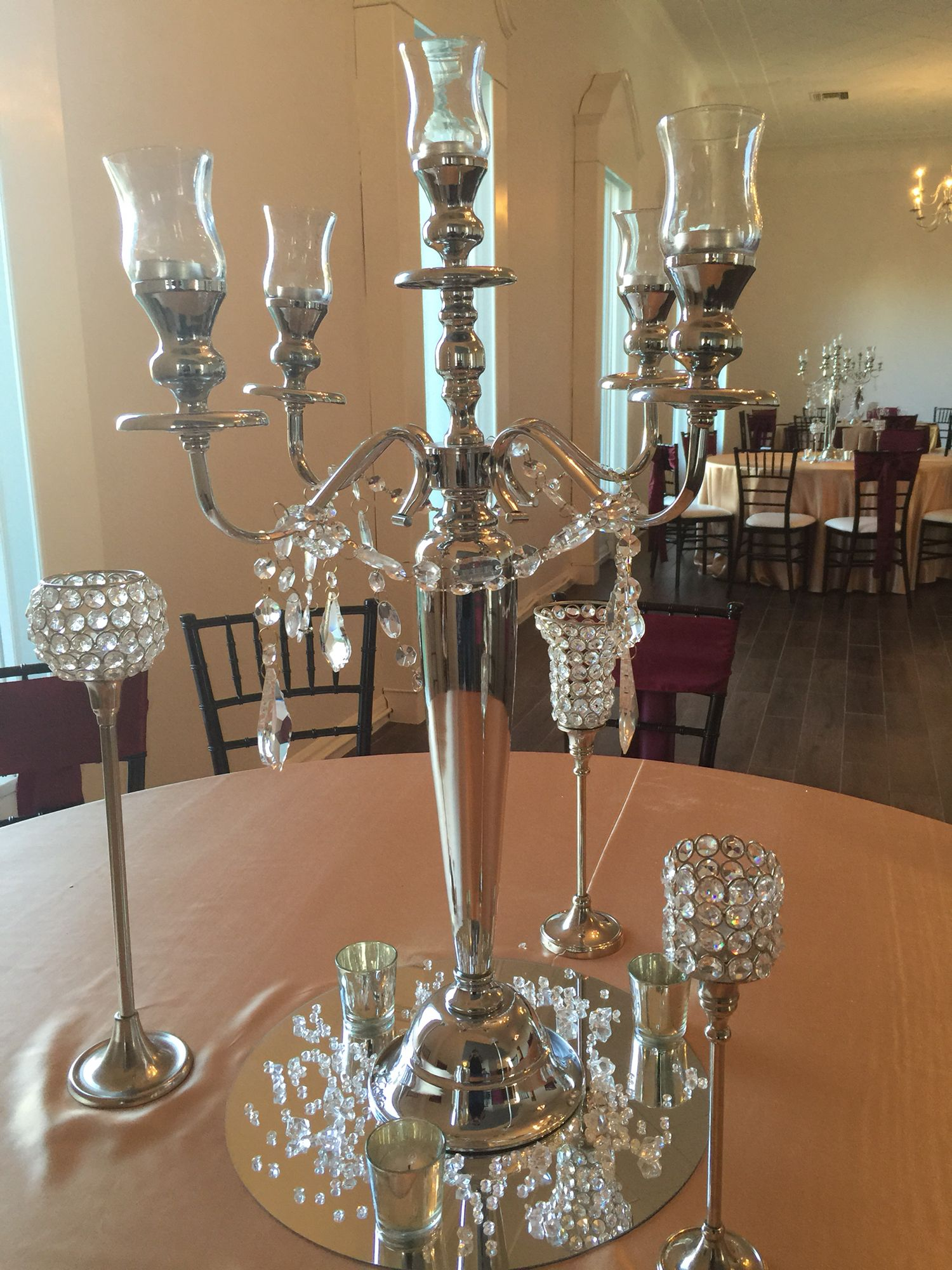 Silver candelabra draped in crystals with bling pieces