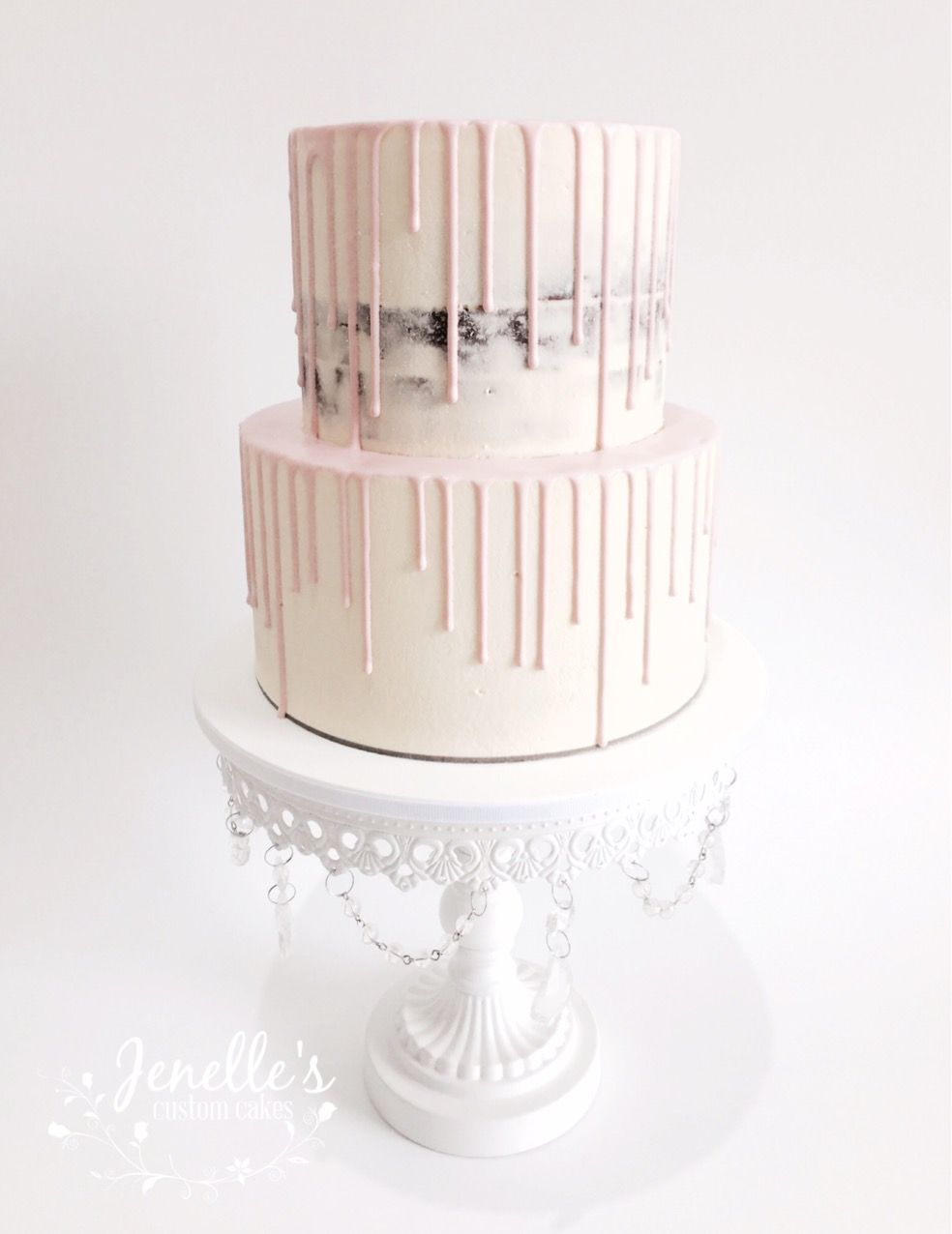 Semi naked cake with pink drip. By Jenelle's Custom Cakes