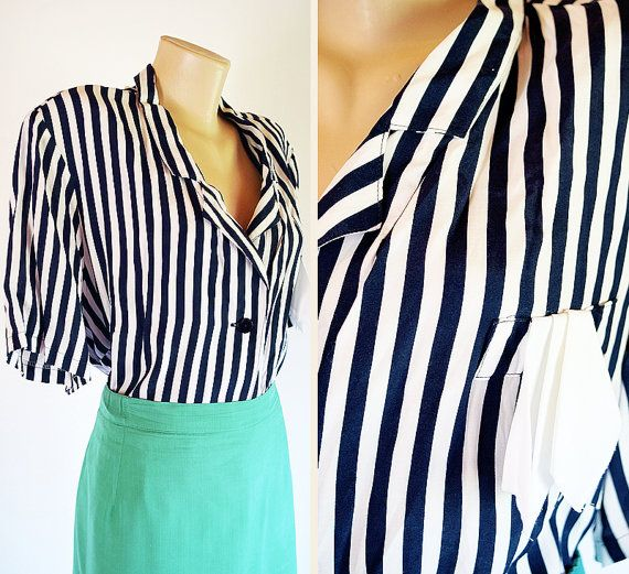 DESCRIPTION: This vintage 1980s blouse is made of 100% viscose with stripes in navy blue and white color  CONDITION: Excellent vintage condition