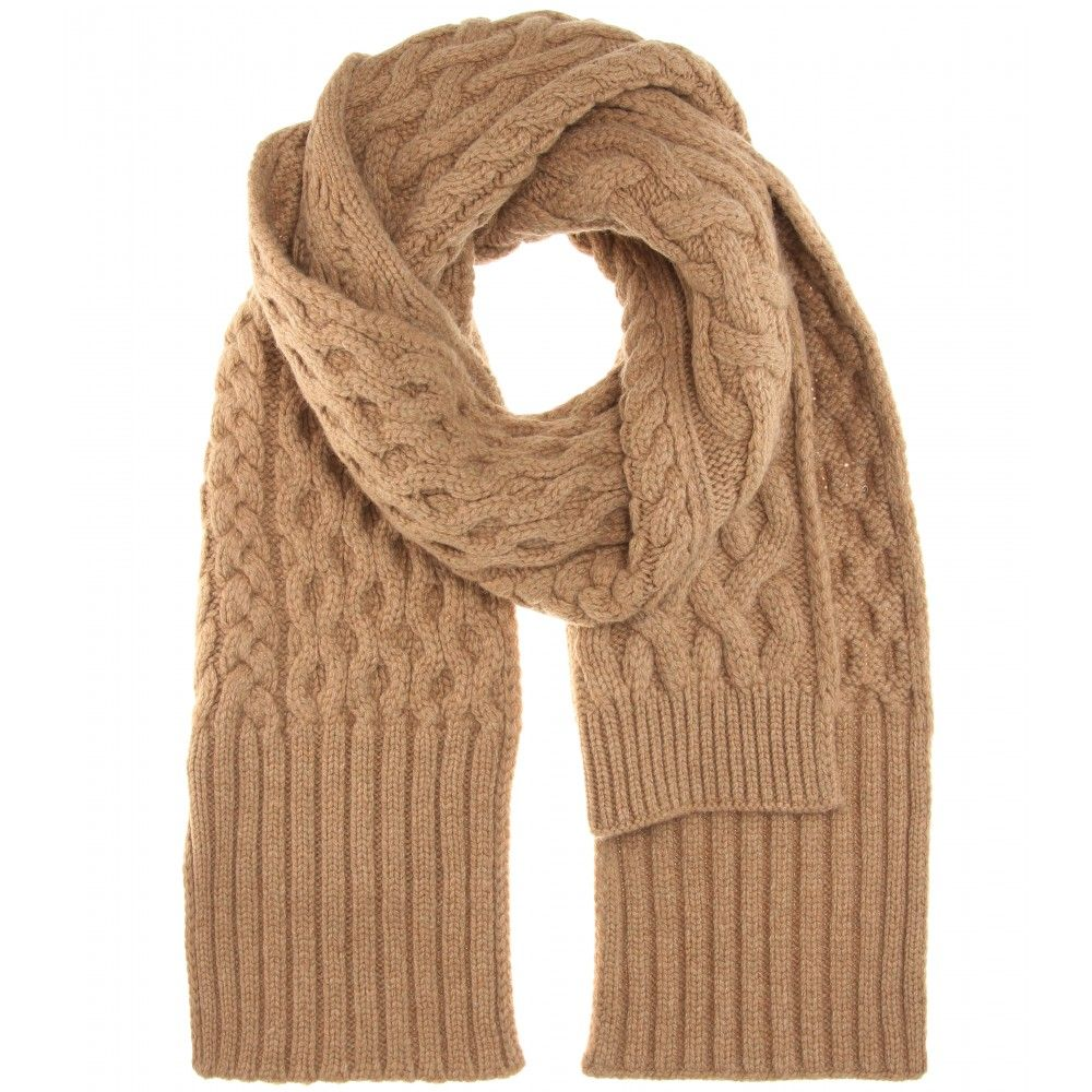 Maison Margiela - Wool scarf - Wrap this scarf from Maison Margiela around your shoulders to combat the cold weather this year. With its warm camel hue, cable-knit design and uneven edge, it looks especially chic paired with plain black trousers and boots. seen @ www.mytheresa.com