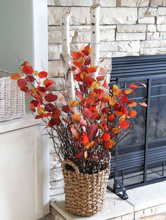 A Bold Fall Decoration Of A Basket With Thick Birch Branches And Branches With Bright Leaves Fall Mantel Decorations Fall Arrangements Diy Fall Decor