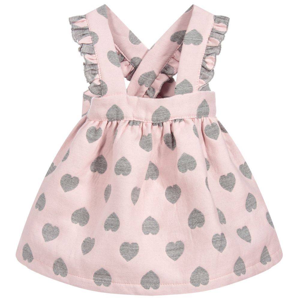Girls Pink Hearts Skirt is part of Pink Clothes For Girls - Girls pink skirt with ruffled shoulder straps from Phi Clothing, made in midweight cotton, with a fun grey heart pattern  The straps fasten with buttons onto the back of the elasticated waistband and are decorated with pretty ruffles  Product number 230032 70% polyester, 30% viscose (soft & midweight) Machine wash (30C) Button fastening shoulder straps Made in Europe