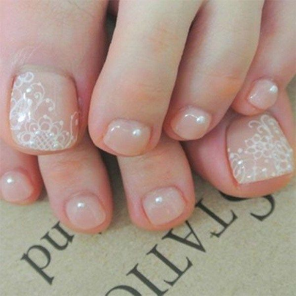 White Lace Details On Nude Nail Polish