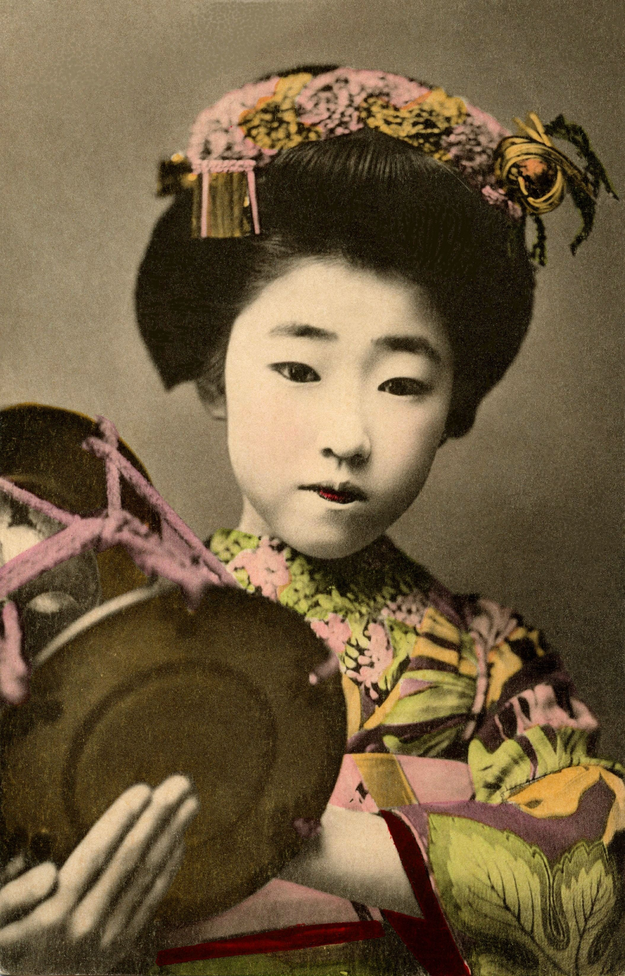 Yachiyo II Playing a Kotsuzumi 1910s A hand-coloured postcard of Maiko…