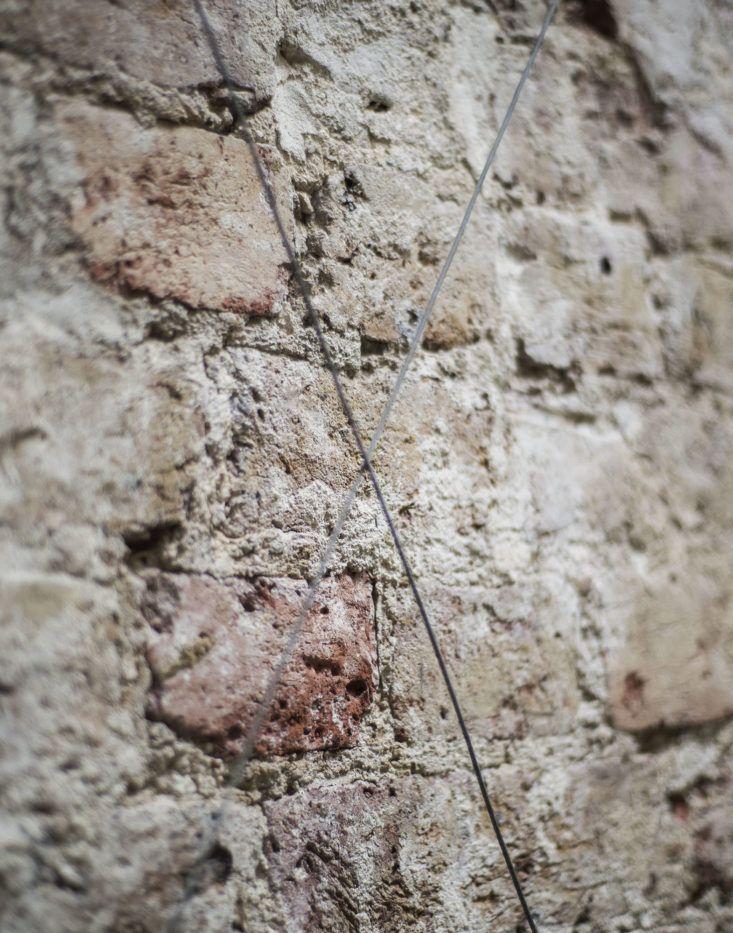 Designer Rose Uniacke London brick wall wire