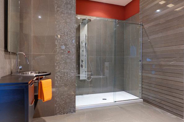 Frameless Shower Enclosure Using A Hydroslide Style System For