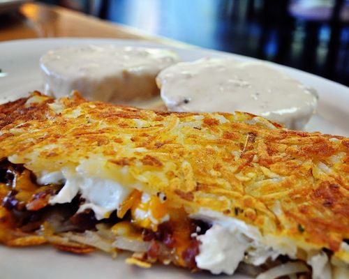 The Hangover Hash Browns Stuffed With Bacon Sour Cream Cheese A Side Of Biscuits Gravy Hashbrown Recipes Breakfast Recipes Breakfast Dishes