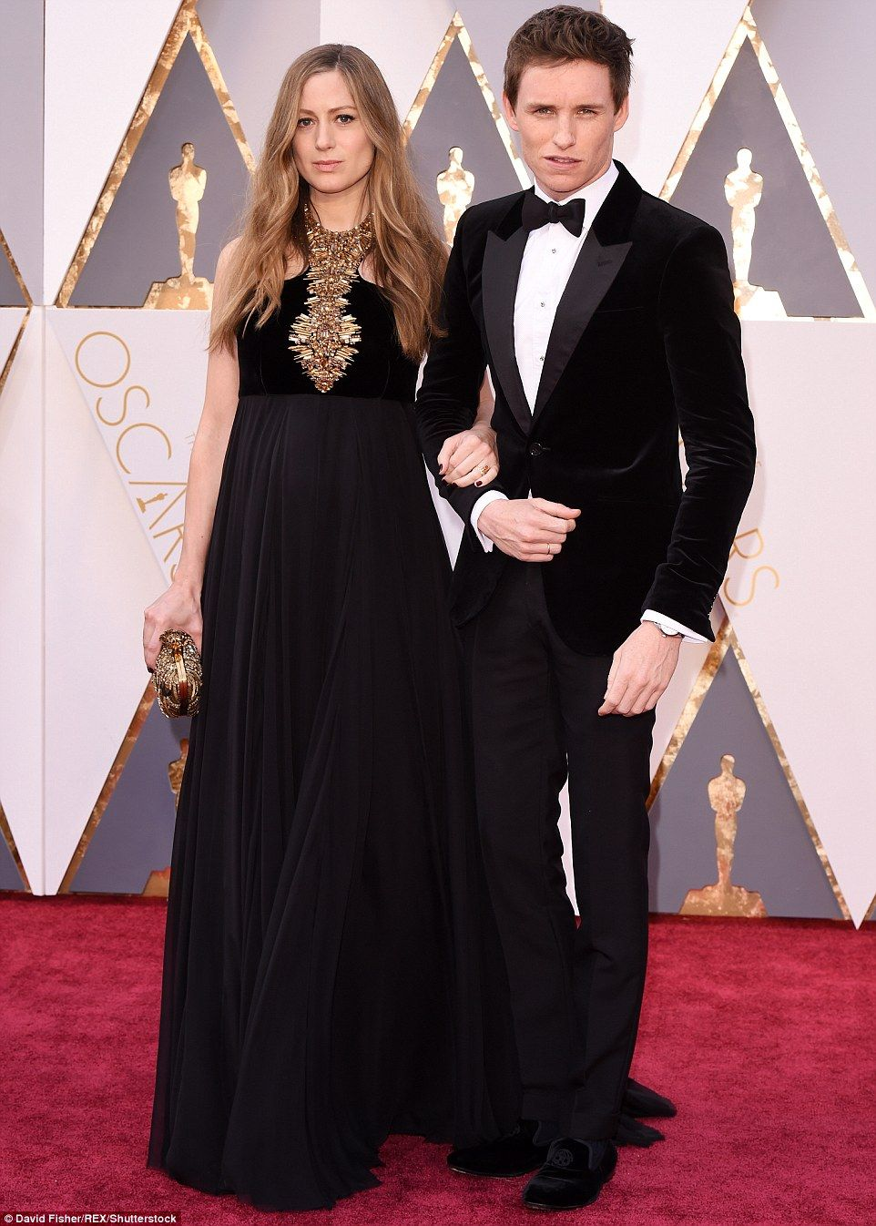 Proud parents-to-be: Eddie Redmayne went arm-in-arm with his lovely wife Hannah Bagshawe, who is expecting their first child together