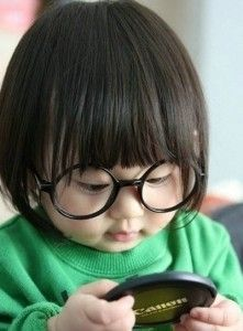Those oversized glasses melt my heart. A little photographer in the making.