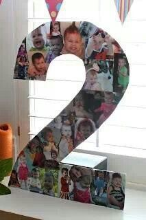 Cardboard number covered in photos from the year. Love it!!!!