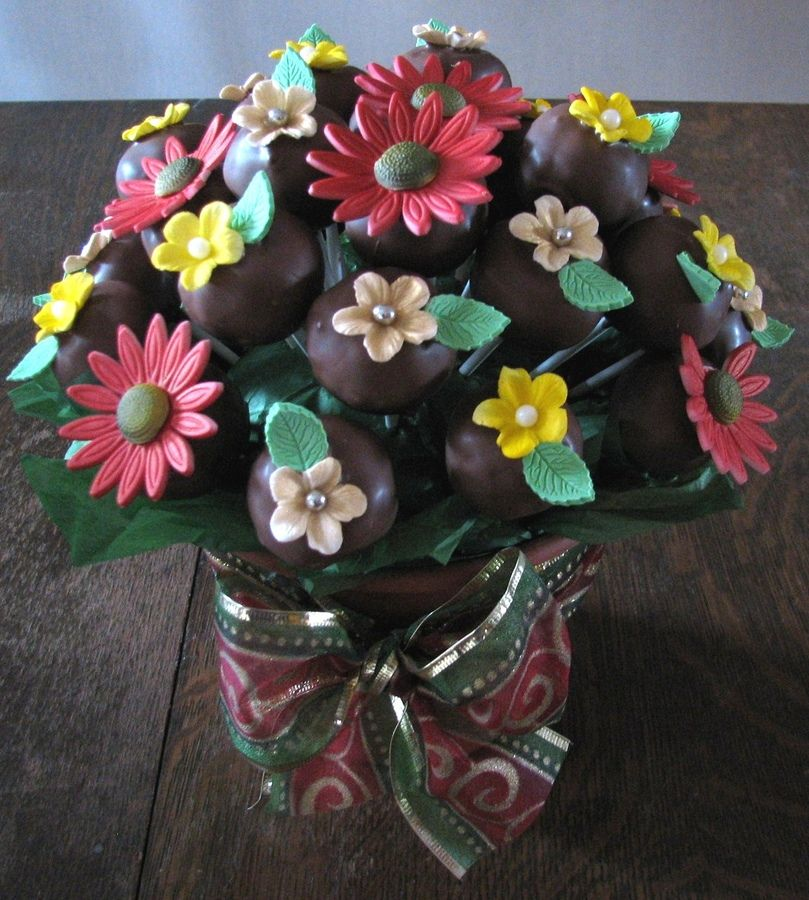 I made these chocolate cake pops and added fondant flowers on them so I could make a bouquet. Thanks for looking.